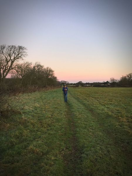 Grass One Person Real People Nature Field Leisure Activity Clear Sky Outdoors Beauty In Nature Landscape Day Sky Walk Dawn Of A New Day Morning Light Rural Scene Scenics Nature Tranquility