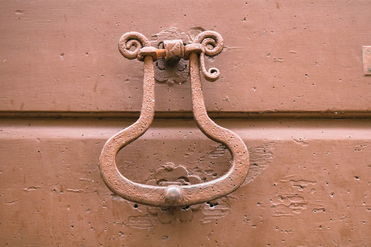 Close-up of chain hanging on metal door
