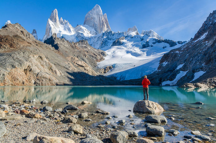 Woman admiring Fitz Roy scenic view Argentina Cold Temperature Day Fitz Roy Glacier Hike Ice Mirror Lake Mountain Nature One Person Outdoors Patagonia Peak Real People Rock - Object Scenics Sky Snow Snow ❄ Summit Travel Travel Photography Trekking Water