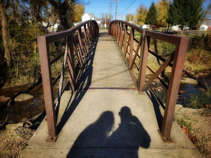 Shadow of people on footbridge