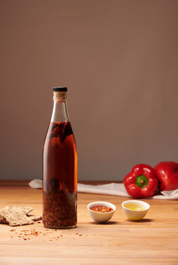 Chili pepper olive oil bottle on table