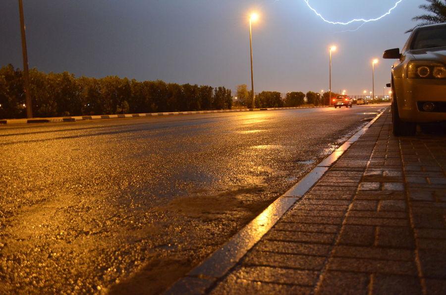 ليت كل من حولي انت، وليت كل الحكي صوتك. Illuminated Night Outdoors Rany Day Road Road Marking Sky Street Street Light The Way Forward Transportation