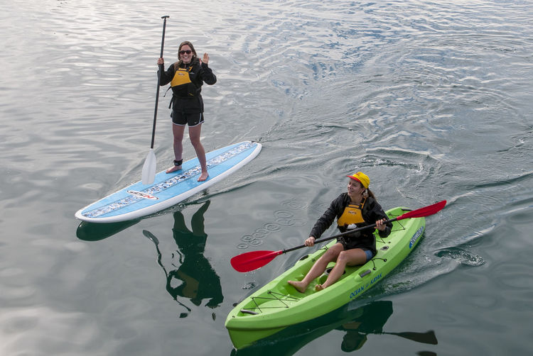 two young ladies enjoying water sports on Wellington Harbour Canoe Wellington  Adventure Harbourtown High Angle View Kayak Leisure Activity Nautical Vessel Oar Paddleboarding Sport Water Waterfront