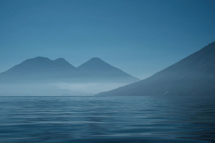 Mountain Sky Beauty In Nature Scenics - Nature Tranquil Scene Water Tranquility Waterfront No People Blue Idyllic Nature Non-urban Scene Mountain Range Clear Sky Copy Space Sea Outdoors Remote Mountain Peak