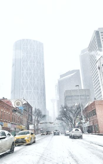 The Bow Snow Warning YYC Chinatown Car Architecture Skyscraper City Building Exterior No People Snow Winter Cold Temperature Built Structure Outdoors Modern Day Sky Yellow Taxi Snowing Cityscape