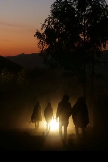Streetphotography People darkness and light Lalibela Ethiopia Tree Sunset Silhouette Full Length Rural Scene Togetherness Sky The Street Photographer - 2019 EyeEm Awards