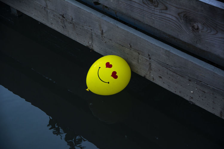 High angle view of yellow balloon in water