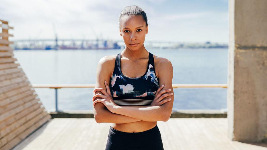 Portrait Of Confident Female Athlete On Footpath