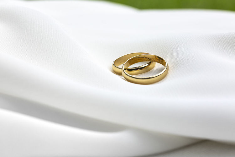 Close-up of wedding rings on white background
