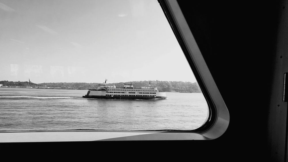 Transportation City Water Ferry Commute Commuting Travel Boat Vessel Sea Sky Business Finance And Industry Architecture Day No People Outdoors Tree Bridge - Man Made Structure Cityscape Traveling Home For The Holidays Black And White Friday