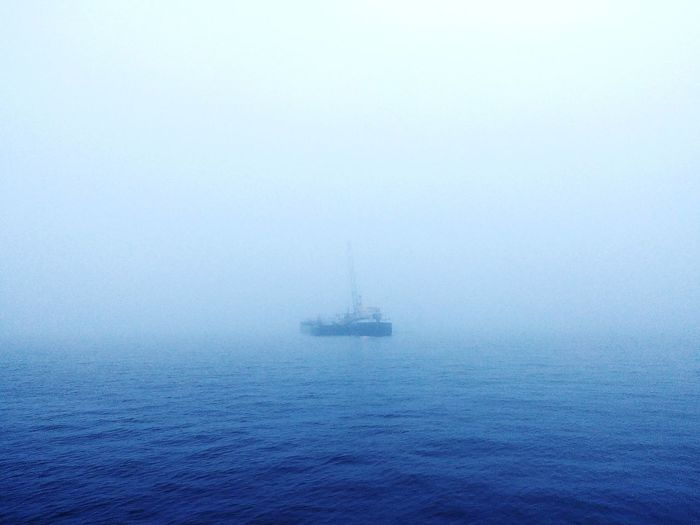 A foggy ferry ride to work. Fog Winter Amsterdam Misty Ship Ferry Commuter Canals Of Amsterdam Amsterdam Transport Blue View 9 To 5 Water Blue Backgrounds Full Frame Close-up Rainy Season Rain Foggy Mist Weather Season  Dew Wet Umbrella EyeEmNewHere