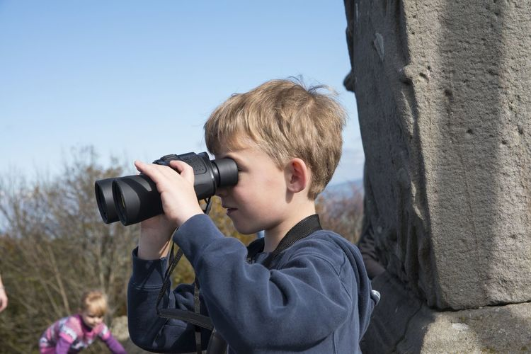 Blond Hair Boys Camera - Photographic Equipment Child Childhood Clear Sky Day Headshot Holding Leisure Activity Nature One Boy Only One Person Outdoors People Photographing Photography Themes Real People Sky Standing Technology Tree