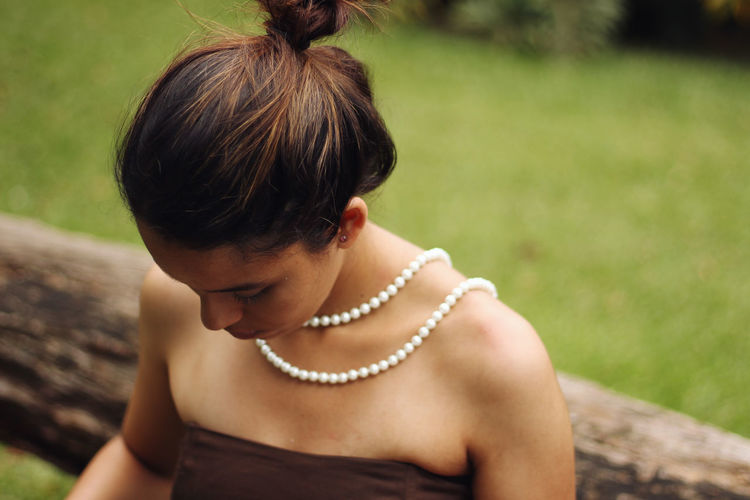 Close-up of a young woman wearing beads