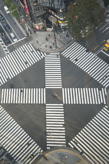 High angle view of person walking on street in city