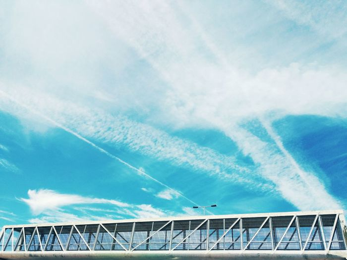 Low Angle View Of Elevated Walkway Against Sky