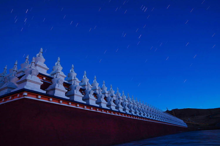Tibet grassland night view China Landscape Sky Nature Beauty In Nature Travel Night Tower Architecture Blue No People Building Exterior Religion Belief Travel Destinations Building Clear Sky Spirituality Outdoors