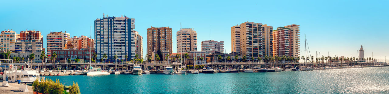 Panoramic view of Benalmadena harbor. Puerto Marina. Malaga, Spain Architecture Bay Of Water Benalmádena, Malaga, Spain Blue Sky Building Exterior City Costa Del Sol Europe Harbor Landscape Malaga Mediterranean Sea Modern Outdoors Port Puerto Marina Benalmadena Residential Building Seaport Skyline Skyscraper SPAIN Town Urban Skyline Waterfront Waterside