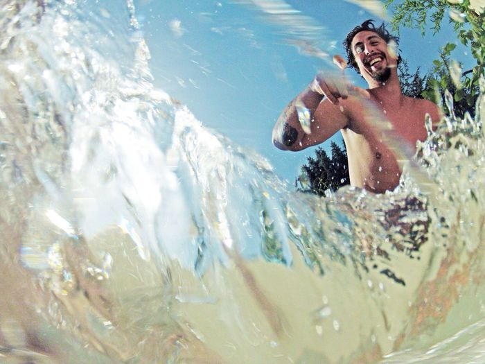 Underwater view of a happy young man