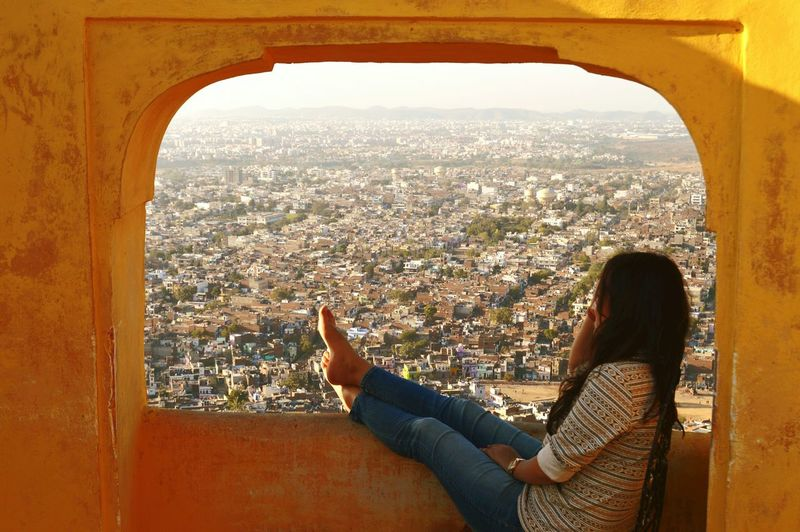 Side view of woman looking at cityscape