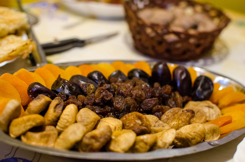 Close-up of dry fruits in plate on table
