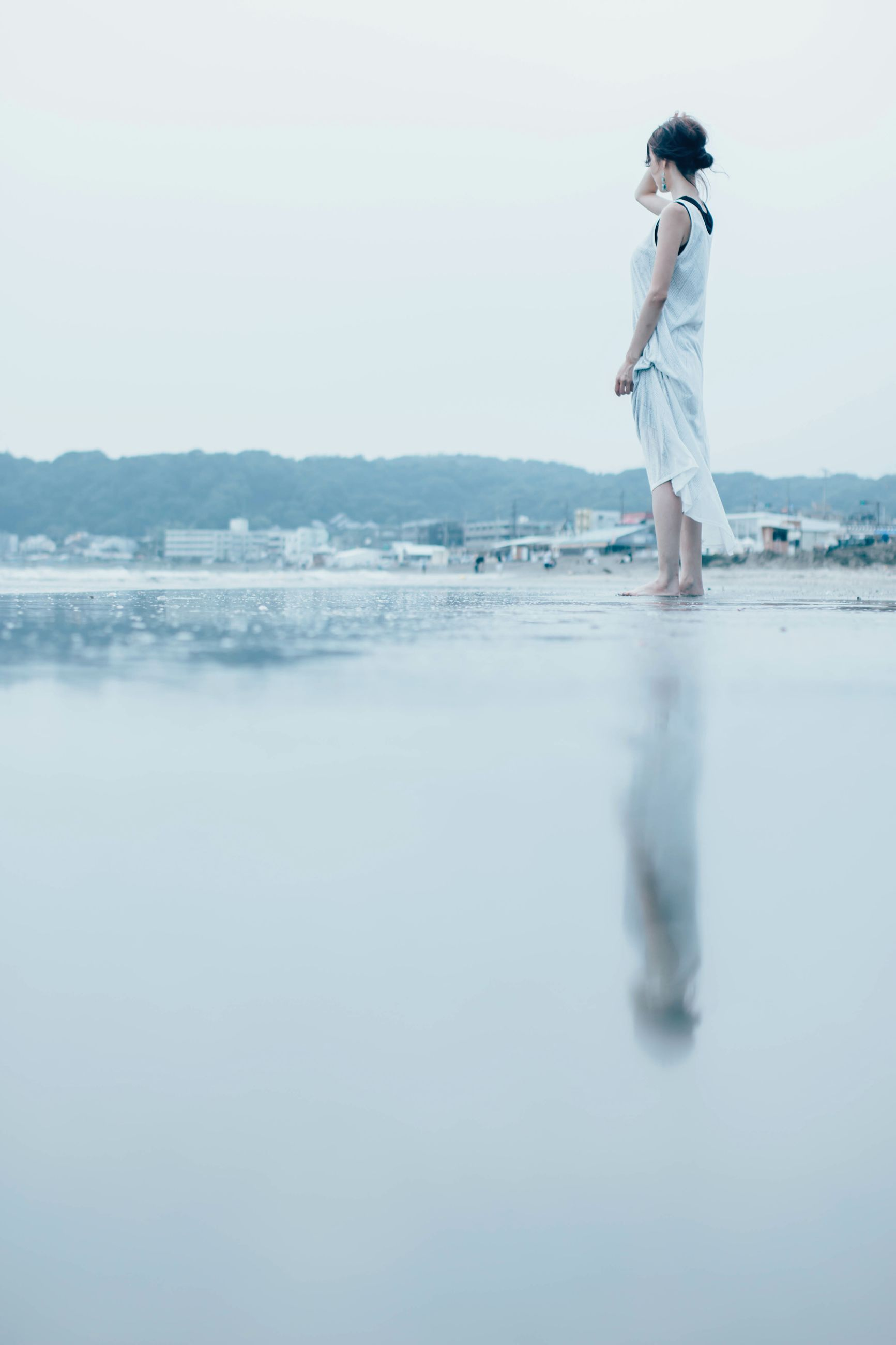 one person, full length, real people, reflection, water, standing, outdoors, young adult, sea, beach, young women, lifestyles, day, beautiful woman, women, nature, beauty in nature, clear sky, sky, people