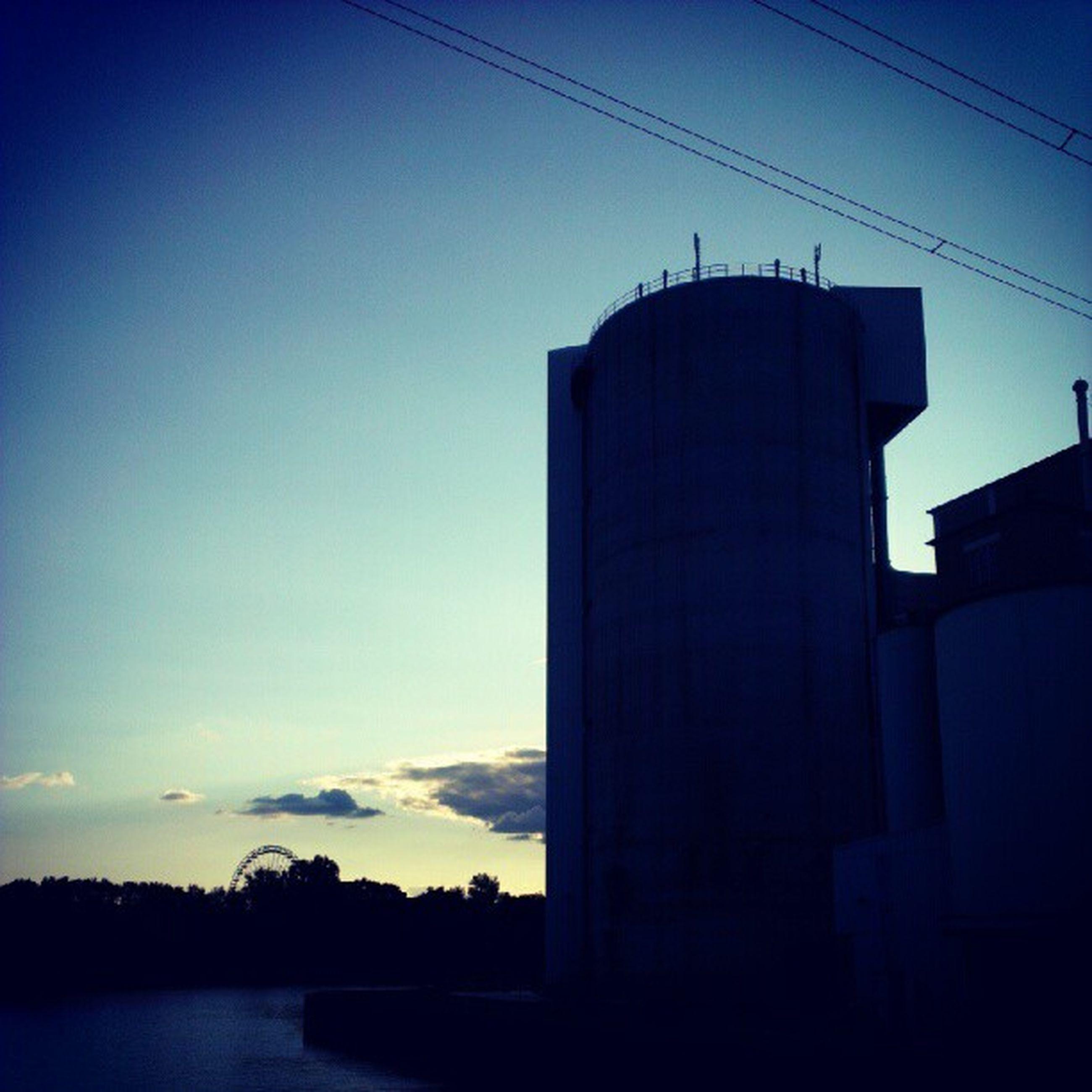 silhouette, architecture, built structure, building exterior, sunset, sky, low angle view, dusk, blue, copy space, power line, clear sky, outdoors, no people, dark, building, connection, electricity pylon, outline, nature