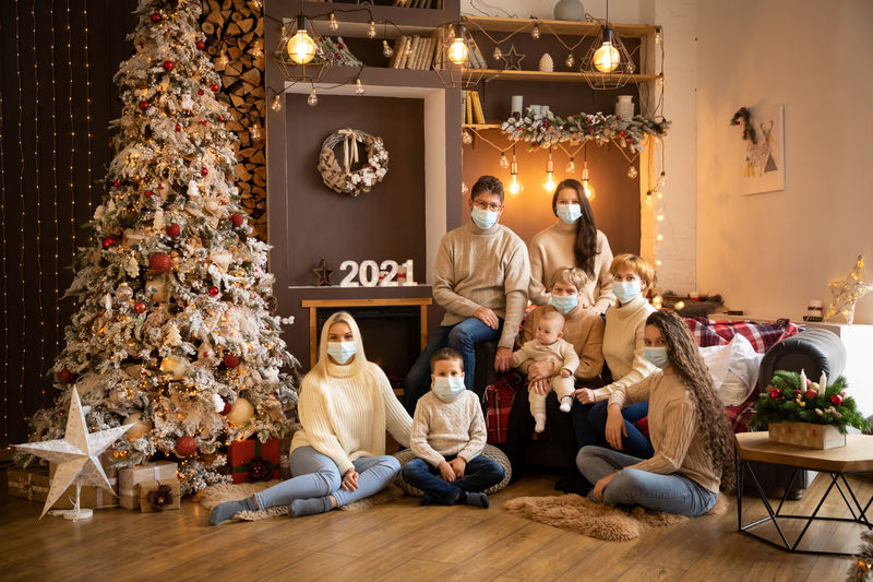 Group of people sitting in illuminated christmas tree