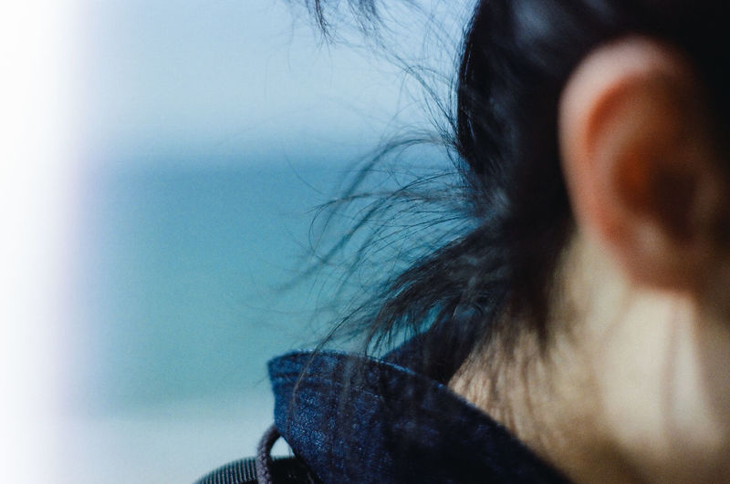Close-up of woman against sky