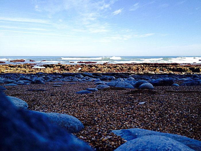 Sea Beach Nature Beauty In Nature Water Pebble Blue Shore Tranquil Scene Horizon Over Water Tranquility Pebble Beach Sky Scenics No People Day Outdoors