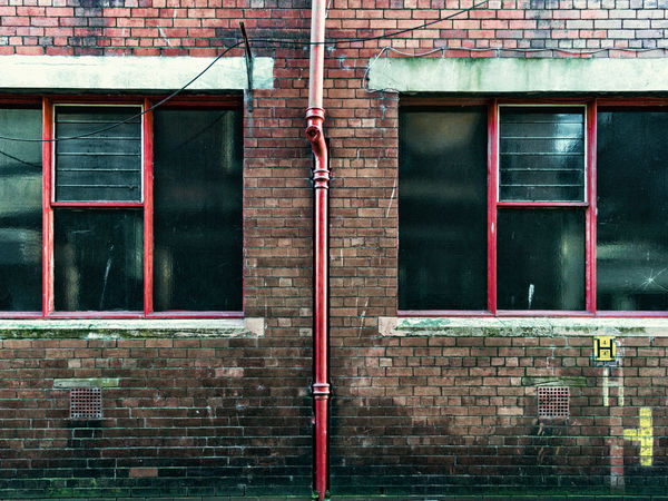 Halves Brickwall City Street Symmetrical Architecture Architecture Building Exterior Built Structure Day Door Drainpipe No People Outdoors Red Color Symmetrical Unloved Urbanphotography Window