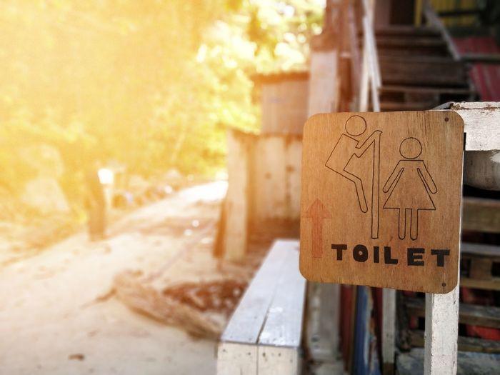 A creative toilet signboard Creative Pervert Signboard Men Women Toilet Washroom Nature Call