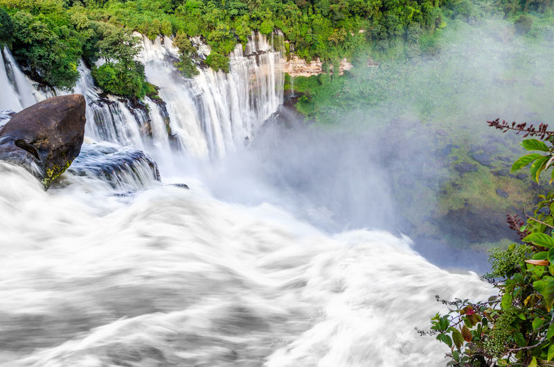 Powerful Kalandula Falls in Angola Angola Beauty In Nature Blurred Motion Calandula Day Environment Flowing Flowing Water Forest Kalandula Long Exposure Motion Nature No People Outdoors Plant Power In Nature Rock Rock - Object Scenics - Nature Solid Tranquil Scene Tree Water Waterfall The Great Outdoors - 2018 EyeEm Awards
