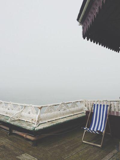 Folding chair on tourist resort in fog