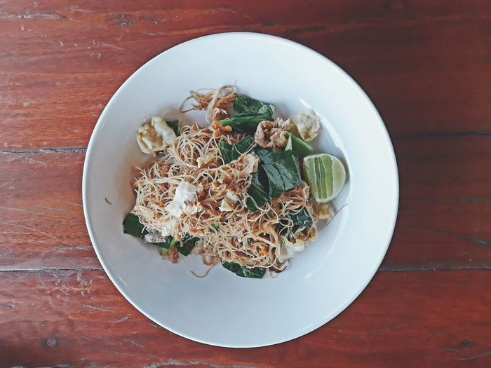 Stir fried vermicelli noodles with soya sauce on wooden table. Preparation  Dish Tasty Thai Food หมี่ผัด Stir Fried Soya Sauce Wooden Table Top View Delicious Vegetables Eat Vermicelli Noodles Table Directly Above Plate Close-up Prepared Food Served Food Styling