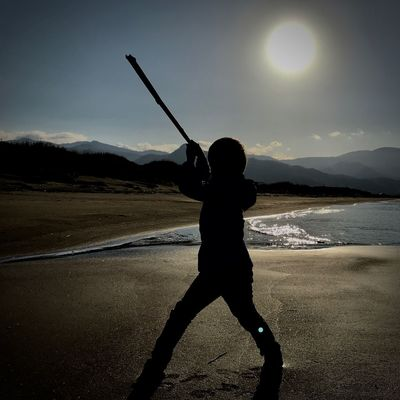 Backlight Kids Action Beach Beauty In Nature Day Leisure Activity Lifestyles Mountain Nature One Person Outdoors People Real People Samurai Silhouette Sky Summer Sword Water