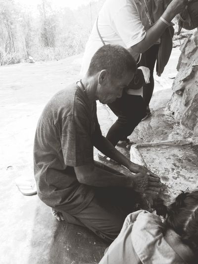 Side view of man sitting outdoors