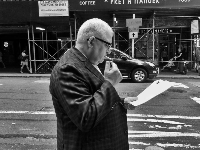 Reading the funnies The Street Photographer - 2015 EyeEm Awards Streetphoto_bw Streetphotography Eye4 The Streets