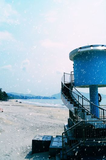 Scenic view of sea against skywater tower on beach against sky