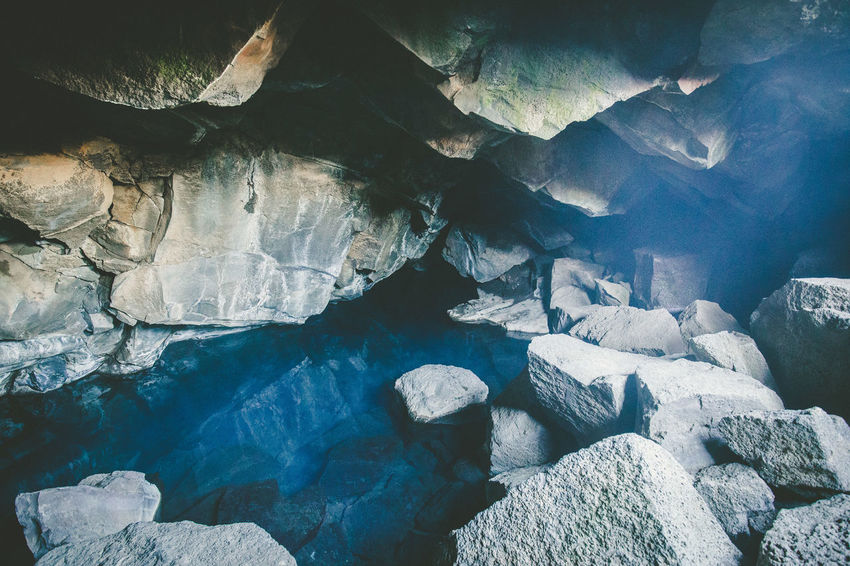 Days of travel: 8 - Grjótagjá, a natural lava cave in Mývatn area. It features a geothermal hot spring inside. The water is heated from volcanic activity deep within the earth. Bathing in the cave dates back to the 18th century. Until the 1970s many Icelanders bathed at Grjótagjá, men in one cave and women in another. The Krafla eruptions from 1975 to 1984 caused the water in the cave to rise above 50°C, and bathing fell out of use. However, the temperature is slowly falling down. Grjótagjá Iceland Beauty In Nature Cave Day Eroded Geology Iceland Trip Iceland_collection Idyllic Natural Pattern Nature No People Non-urban Scene Outdoors Physical Geography Rock Rock - Object Rock Formation Solid Tranquil Scene Tranquility Water Water Collection  Waterfront
