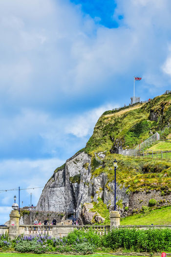 Blue Cliff Cloud Cloud - Sky Day Grass Grass Area Green Green Color Growth Hill Nature Outdoors Plant Portrait Landscape Remote Scenics Sky Tourism Tranquil Scene Tranquility Union Flag