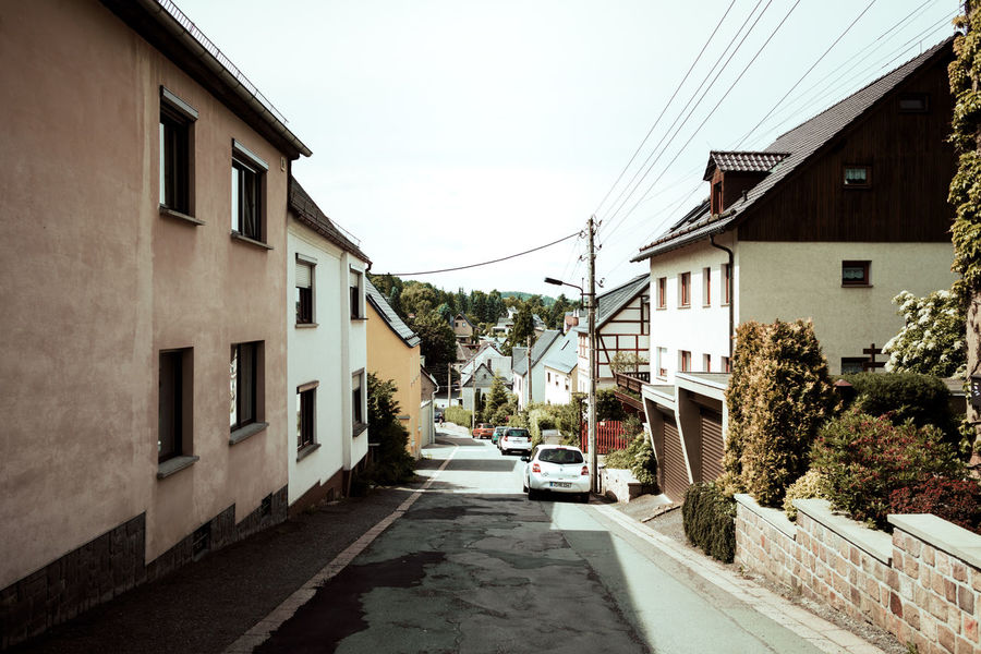 Architecture Building Exterior Built Structure Cable Car City Clear Sky Day Daylight Hillside House No People Outdoors Residential Building Road Saxony Sky Street Streetphotography The Way Forward Transportation Tree Valley Village Life Village View