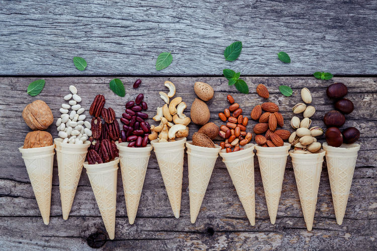 Directly Above Shot Of Nuts In Ice Cream Cones