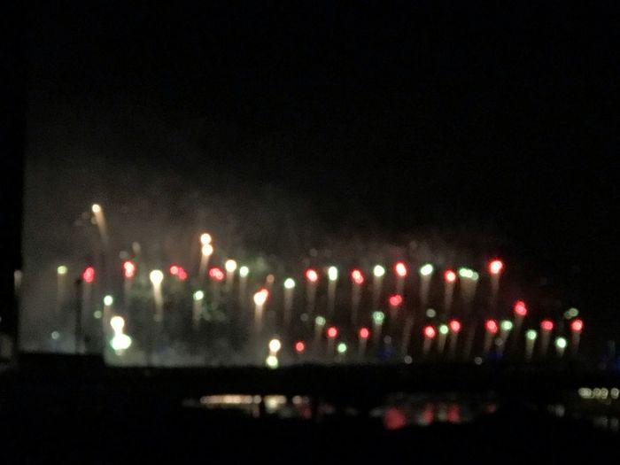 Defocused image of illuminated lights in city at night