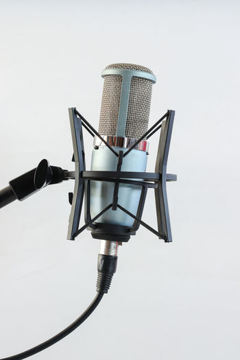 Microphone on White background No People Technology Studio Shot Indoors  Close-up Metal White Background Arts Culture And Entertainment Copy Space Cable Input Device Communication Microphone Single Object Equipment Music Day Black Color Still Life