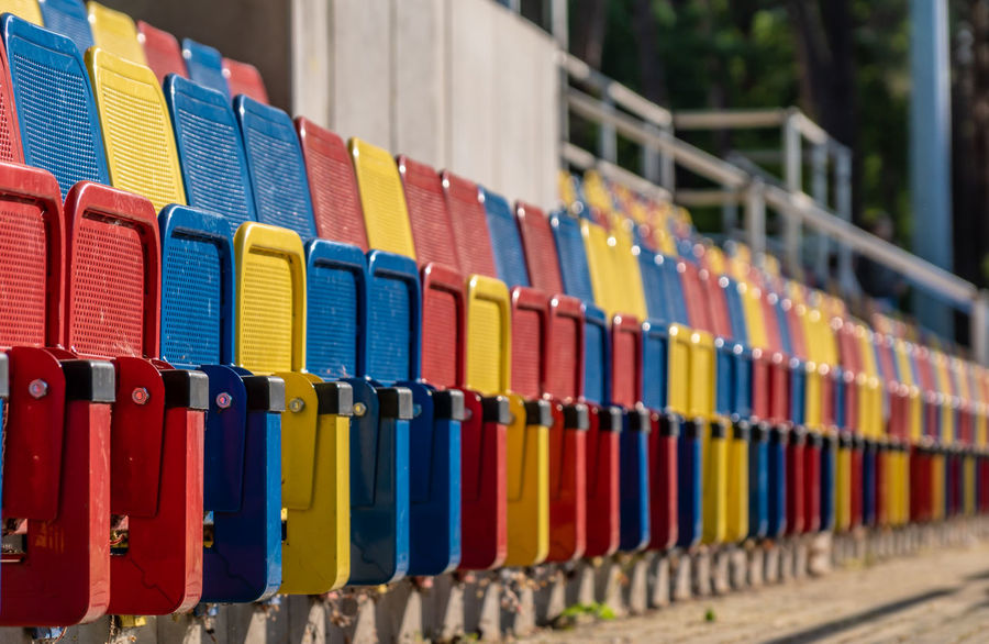 In A Row Stadium Stadium Seating Abundance Arrangement Barrier Business Choice Close-up Collection Day Focus On Foreground Hockey In A Row Large Group Of Objects Metal Multi Colored No People Order Outdoors Repetition Seat Seating Bench Selective Focus Side By Side Soccer Sport Sport Arena Variation The Architect - 2018 EyeEm Awards The Still Life Photographer - 2018 EyeEm Awards Summer Sports