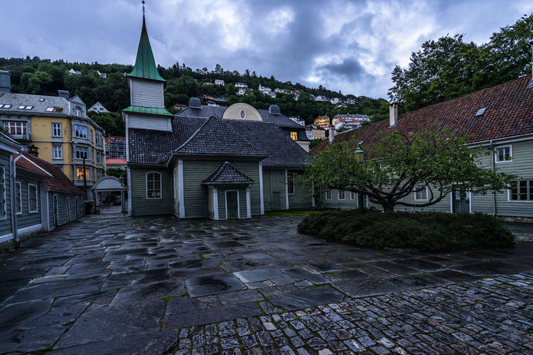 Yard of the Leprosy Museum, former St. Jorgen hospital, a typical Norwegian building in Bergen old town, Norway Norway Norway🇳🇴 Norge Northern Europe Scandinavia Bergen Bergen,Norway Architecture Built Structure Building Exterior Building Cloud - Sky Sky City Residential District Nature House No People Plant Tree Day Roof Outdoors Street Cobblestone Place Of Worship Town TOWNSCAPE