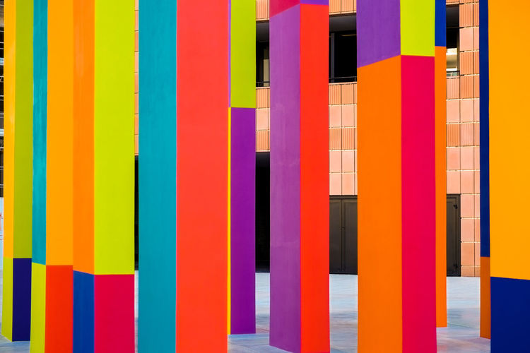 Abstract geometric pattern on concrete wall Architecture Backgrounds Built Structure Choice Close-up Creativity Day Full Frame In A Row Indoors  Large Group Of Objects Multi Colored No People Pattern Side By Side Striped Variation Vibrant Color Wall - Building Feature Yellow