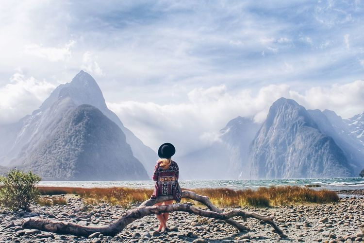 Rear view of woman looking at milford sound