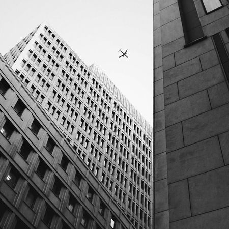 Sky Plane Airplane Arquitecture Flying Building Exterior Low Angle View Outdoors City No People