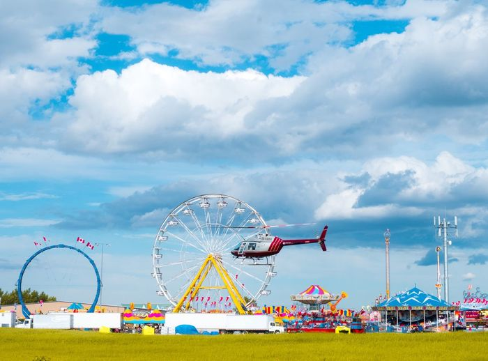 Amusement park Sky Cloud - Sky Amusement Park Amusement Park Ride Ferris Wheel Arts Culture And Entertainment Nature Day Fun Outdoors Travel Architecture Holiday Carnival Enjoyment Leisure Activity Vacations Traveling Carnival Multi Colored Travel Destinations
